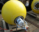 Yellow mooring float with ice profiler in frame. Photo by Scott McKeever