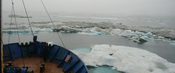 Russian Vessel Khromov picks its way through dirty ice near Herald Island. [Photo: K. Wood]
