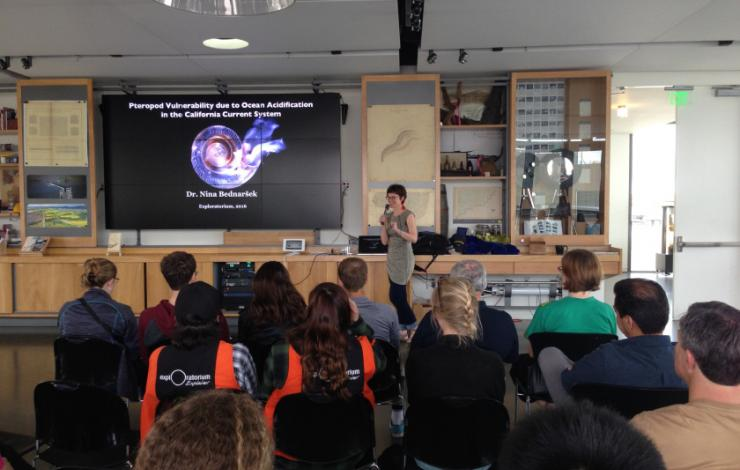 Nina Bednarsek presenting at the Exploratorium during the West Coast Ocean Acidification Cruise in 2016