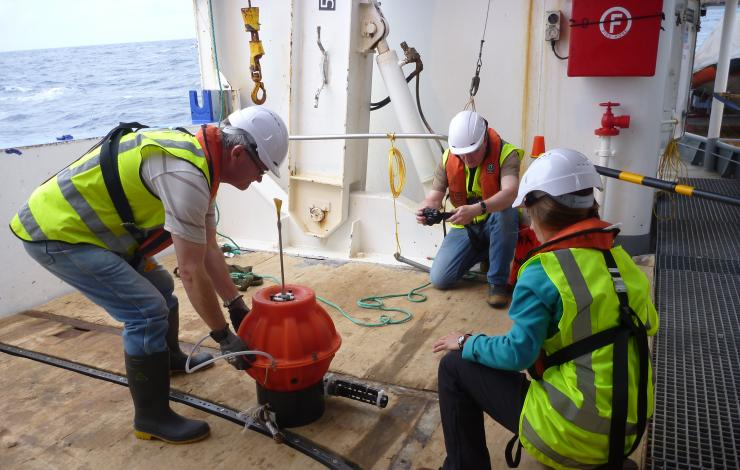 Scientists prepare to deploy Deep Argo float off New Zealand in 2014.