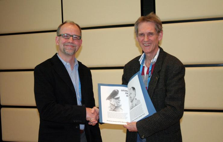 photo of Dr. Greg Johnson receiving the Georg Wust prize