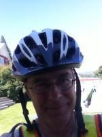 "John ""Oz"" in his bike helmet on a sunny day"